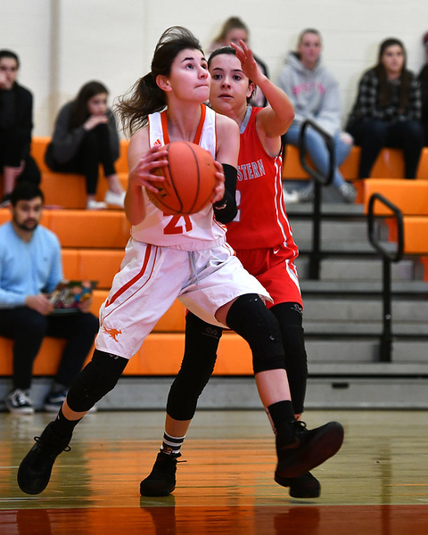 12/26/2019 Mike Orazzi | Staff\rTerryville High School's Amy Roqi (21) and Northwestern's Francesca DeSanti (2) during Thursday's girls basketball game in Terryville.