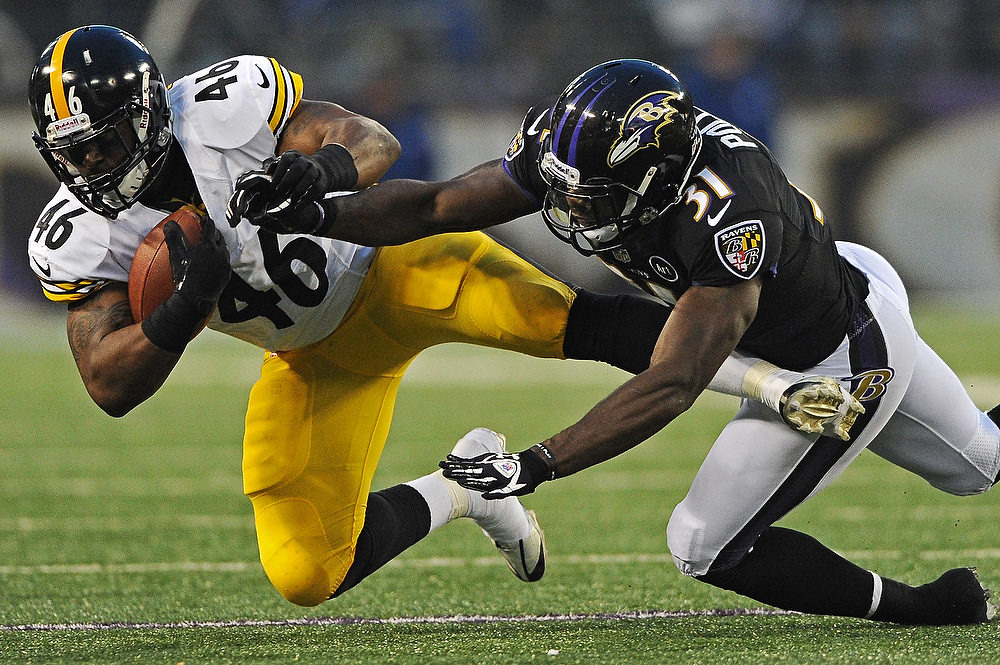 Description of . Fullback Will Johnson #46 of the Pittsburgh Steelers is tackled by safety Bernard Pollard #31 of the Baltimore Ravens in the first quarter at M&T Bank Stadium on December 2, 2012 in Baltimore, Maryland. (Photo by Patrick Smith/Getty Images)