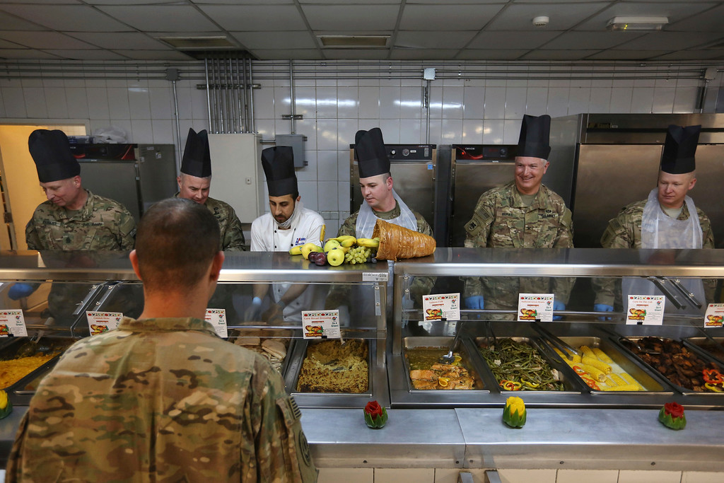 . A NATO soldier lines up to take have a Thanksgiving day meal at Resolute Support headquarters, in Kabul, Afghanistan, Thursday, Nov. 24, 2016. (AP Photo/Rahmat Gul)