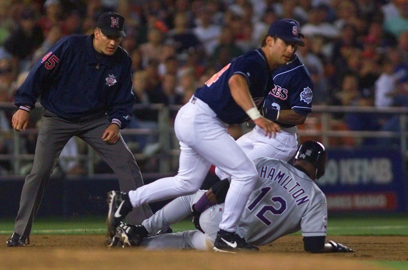. San Diego Padres\' third baseman George Arias puts the tag on Colorado Rockies\' Darryl Hamilton after Hamilton  was off second base on an infield grounder in the fifth inning of their game Monday June 28, 1999 in San Diego. The play slowed a Rockies\' rally in which they scored only one run. The umpire is Hunter Wendelstedt. (AP Photo/Lenny Ignelzi)