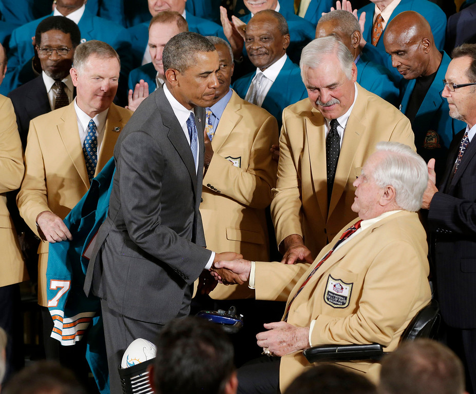 . President Barack Obama shakes hands with Hall of Fame football Coach Don Shula, right seated, during a ceremony in the East Room of the White House in Washington, Tuesday, Aug. 20, 2013, where the president honored the Super Bowl VII football Champion Miami Dolphins. From left are, quarterback Bob Griese, the president and running back Larry Csonka and Shula. The 1972 Miami Dolphins remain the only undefeated team in NFL history. (AP Photo/Pablo Martinez Monsivais)