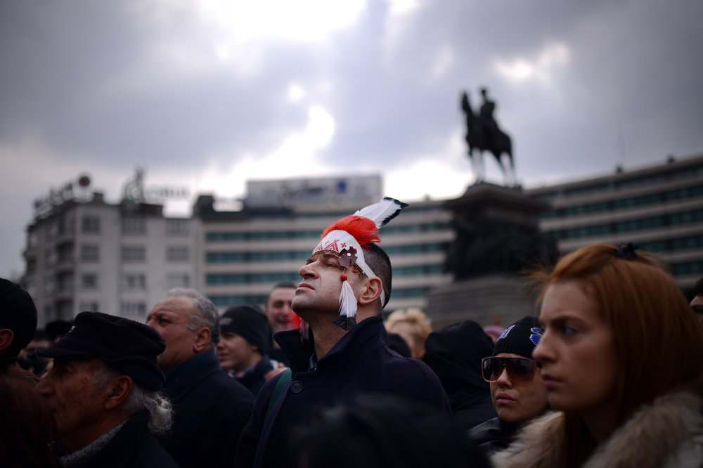 . Bulgarians attend a protest in front of the Bulgarian Parliament building in Sofia on February 17, 2013. Protesters threw rocks, firecrackers, bottles, eggs and tomatoes at the police line manning the headquarters of Czech power producer CEZ and the president\'s office to protest against sky-high January electricity bills in the EU\'s poorest country, as the government drags its feet on liberalizing the energy market. DIMITAR DILKOFF/AFP/Getty Images