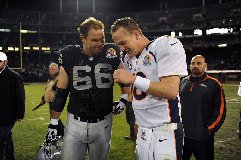 . Oakland Raiders guard Cooper Carlisle #66 waited for Denver Broncos quarterback Peyton Manning #18 for a little talk after their game at the O.co Coliseum, in Oakland , CA December 06, 2012.      Joe Amon, The Denver Post