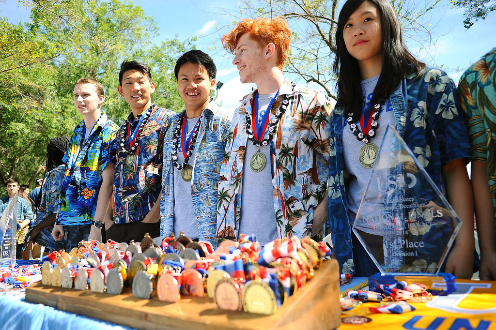 . Members of El Camino Real Charter High School\'s Academic Decathlon team pose for photos during a rally in honor of their seventh national title last week in Honolulu, Hawaii.(Andy Holzman/Los Angeles Daily News)