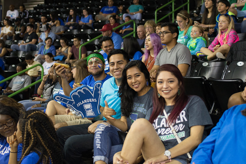 Students await the start of the Islander Homecoming Basketball game.