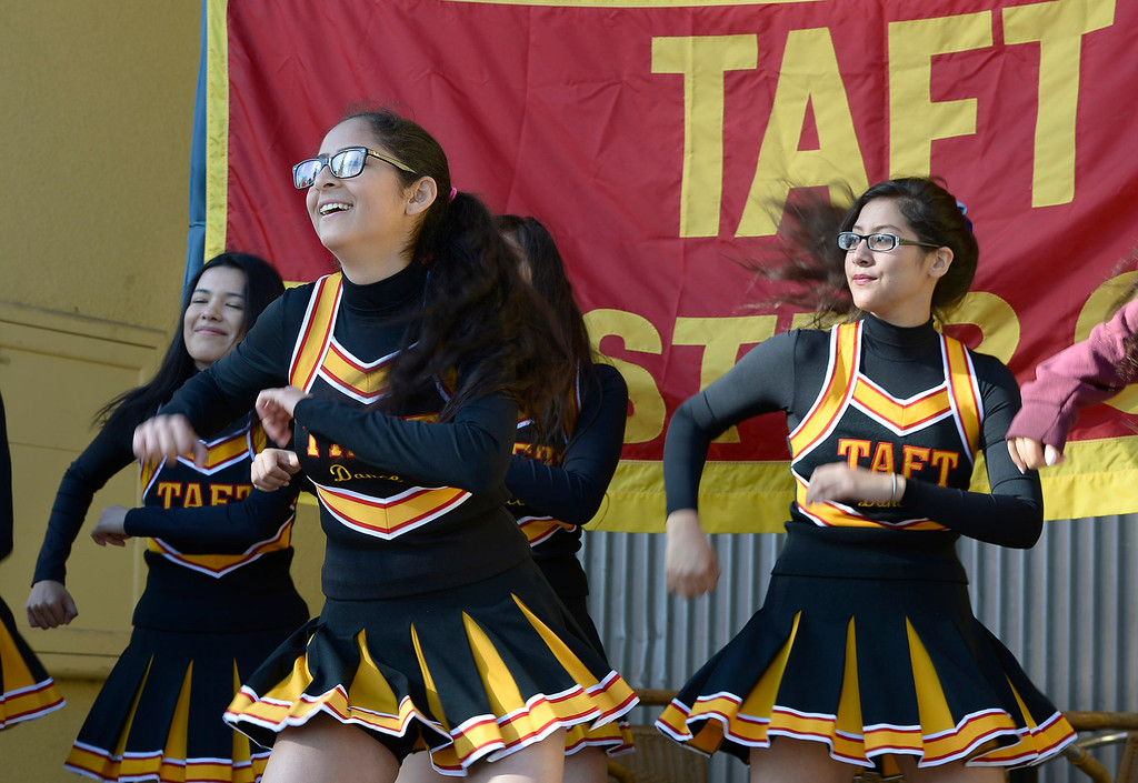 . Taft High School cheerleaders celebrate as the school opens a full-scale Antiques and Collectibles Mart that occur every Saturday in the school parking lot. The school will receive a portion of the proceeds that is not funneled through and picked over by LAUSD. Los Angeles, CA. March 15, 2014 (Photo by John McCoy / Los Angeles Daily News)