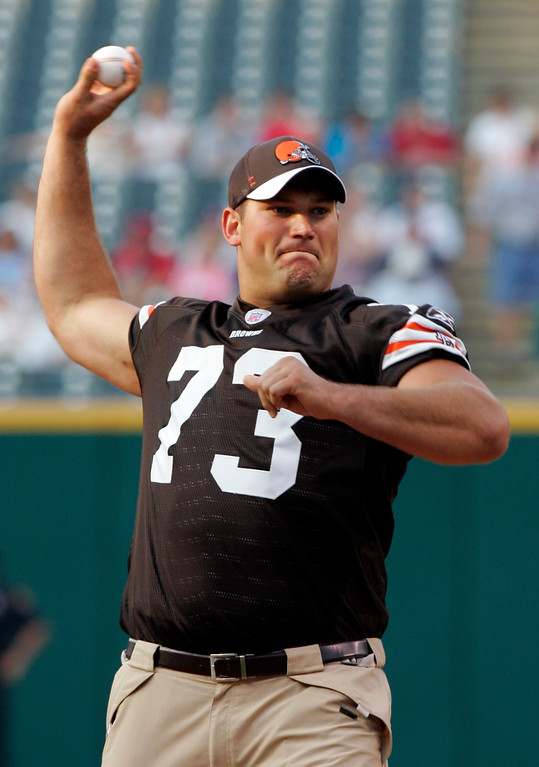 . Cleveland Browns top draft pick, offensive tackle Joe Thomas, throws out a pitch before the Cleveland Indians hosted the Philadelphia Phillies in a baseball game Monday, June 18, 2007, in Cleveland. (AP Photo/Mark Duncan)