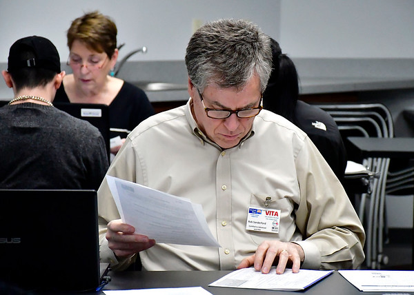 2/19/2019 Mike Orazzi | Staff Rob Sanderford looks over tax returns during a program by the United Way of West Central Connecticut, in partnership with HRA of New Britain, for a free tax preparation site for individuals residing in Bristol, Burlington, Plainville, Plymouth and Terryville throughout the tax season in Bristol Tuesday.