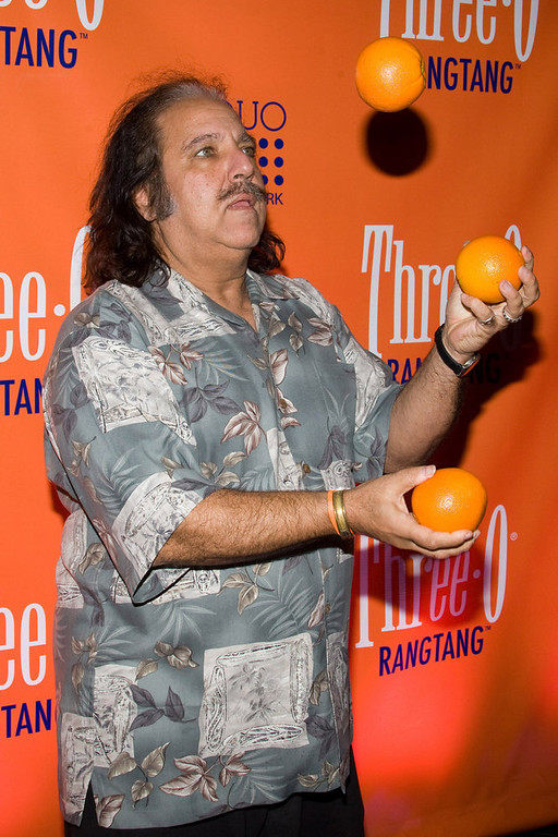 ". Ron Jeremy juggles oranges at the launch party for Three-O Vodka\'s new flavor ""Rangtang\"" in New York, Tuesday, Feb. 23, 2010. (AP Photo/Charles Sykes)"