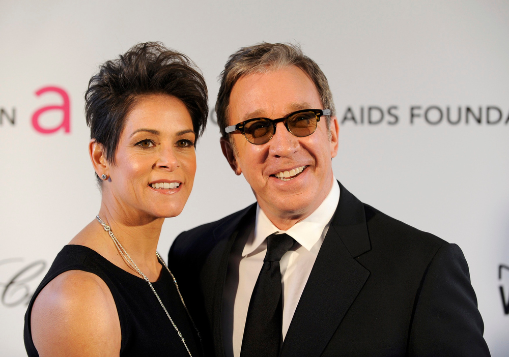 Description of . Actor Tim Allen (R) and his wife Jane Hajduk arrive at the 2013 Elton John AIDS Foundation Oscar Party in West Hollywood, California, February 24, 2013.  REUTERS/Gus Ruelas