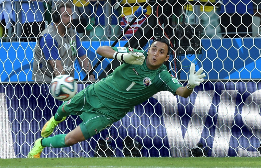 . Costa Rica\'s goalkeeper Keylor Navas fails to save a penalty kick during a Group D football match between Uruguay and Costa Rica at the Castelao Stadium in Fortaleza during the 2014 FIFA World Cup on June 14, 2014. AFP PHOTO / GABRIEL BOUYS