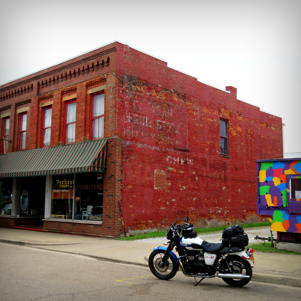 ghost sign and triumph bonneville in point pleasant west virginia
