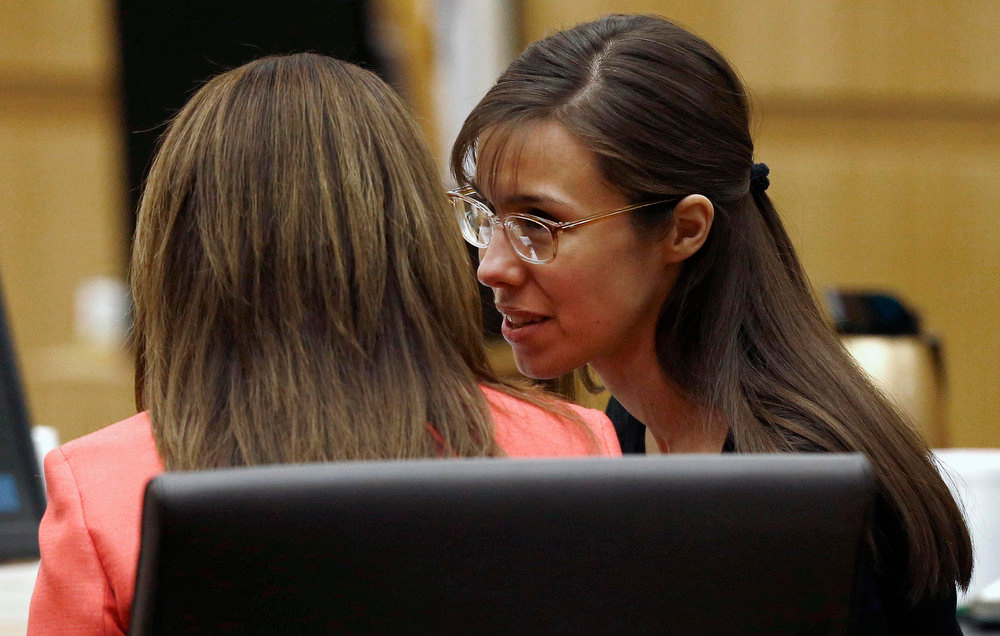 . Defense attorney Jennifer Wilmott listens to defendant Jodi Arias, right, as lead defense attorney Kirk Nurmi make his closing arguments  during her trial Friday, May 3, 2013 at Maricopa County Superior Court in Phoenix.  Arias is charged with first-degree murder in the stabbing and shooting death of Travis Alexander, 30, in his suburban Phoenix home in June 2008. (AP Photo/The Arizona Republic, Rob Schumacher, Pool)