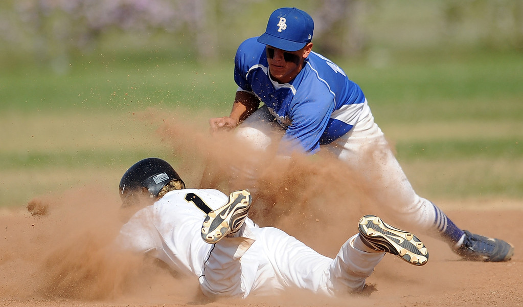 . Northview\'s Gabe Rojo (1) safe at second base ahead of the tag by Baldwin Park shortstop Jonatan Huerta in the fourth inning of a prep baseball game at Northview High School on Tuesday, April 23, 2012 in Covina, Calif. Northview won 8-2.    (Keith Birmingham/Pasadena Star-News)