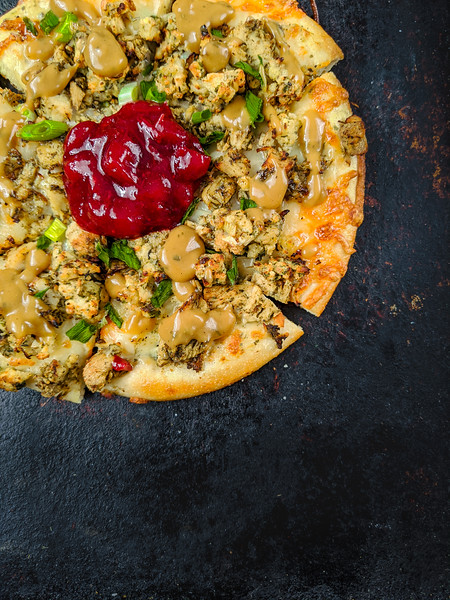 Christmas pizza with gravy quarter.jpg