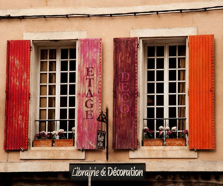 Colorful windows in L'Isle Sur-la-Sorgue