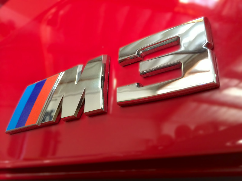 MBW M3 logo on a bright red BMW