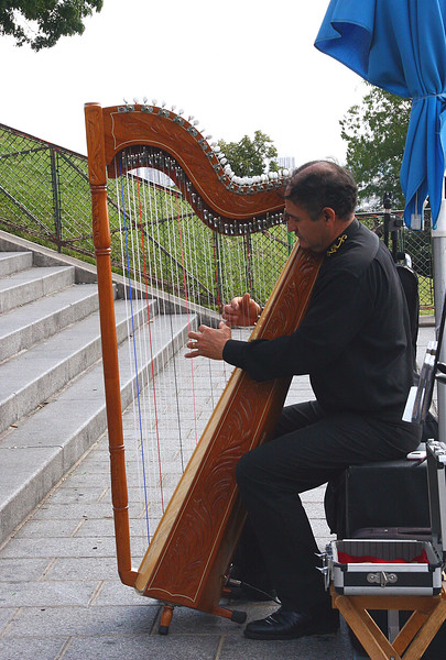 He played the harp beautifully, on the steps of the church