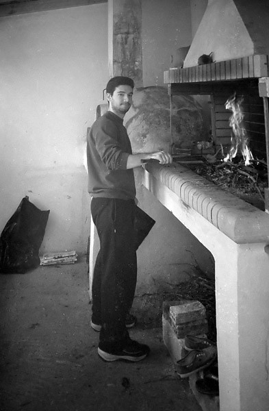 Doing real BBQ, with real wood (as opposed to heat beads or gas), preparing to cook real meat... (Winter 2001)