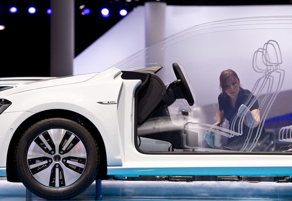. A cutaway model of the new e-Golf by car manufacturer Volkswagen, VW, is being cleaned by an employee at the Frankfurt Auto Show, IAA, in Frankfurt, Germany, Monday, Sept. 9, 2013 2013. The 65th IAA will take place from Sept. 12 until Sept. 22, 2013. (AP Photo/dpa, Boris Roessler)