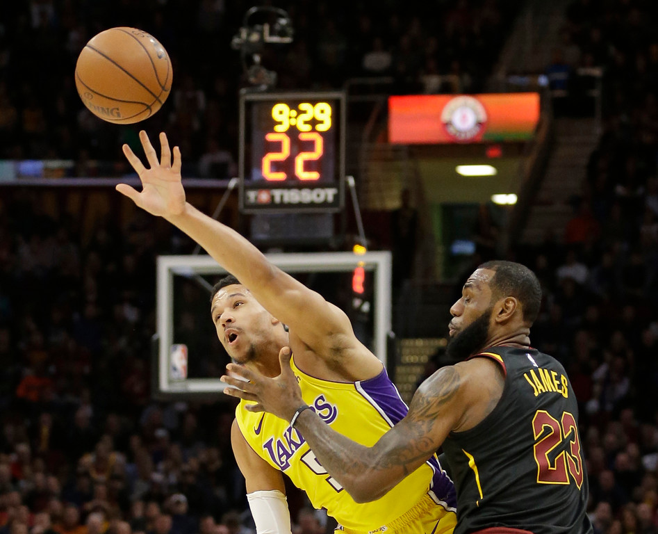 . Los Angeles Lakers\' Josh Hart (5) grabs a pass ahead of Cleveland Cavaliers\' LeBron James (23) in the first half of an NBA basketball game, Thursday, Dec. 14, 2017, in Cleveland. (AP Photo/Tony Dejak)