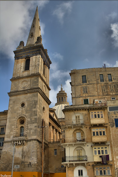 Valletta, Malta.   St Paul's Cathedral Spire and, behind, the dome of Our lady of Mount Carmel   03/23/2019 This work is licensed under a Creative Commons Attribution- NonCommercial 4.0 International License