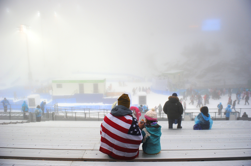 . Spectators wait in the stands a few hours before the women\'s Freestyle Skiing Aerials final at Cypress Mountain, north of Vancouver on February 24, 2010 during the Vancouver Winter Olympics. (MARTIN BUREAU/AFP/Getty Images)