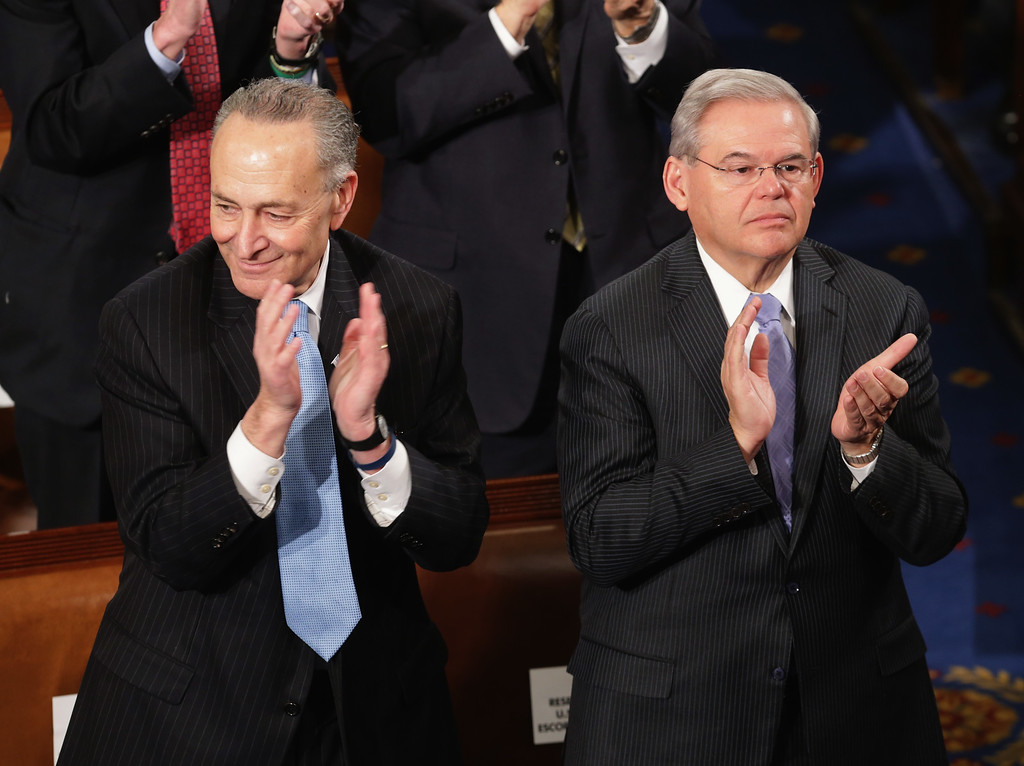 . Sen. Charles Schumer (D-NY) (L) and Foreign Relations Committee ranking member Sen. Robert Menendez (D-NJ) (R) applaud while Israeli Prime Minister Benjamin Netanyahu deliveres a speech on Iran before a joint meeting of the United States Congress in the House chamber at the U.S. Capitol March 3, 2015 in Washington, DC. At the risk of further straining the relationship between Israel and the Obama Administration, Netanyahu warned members of Congress against what he considers an ill-advised nuclear deal with Iran.  (Photo by Chip Somodevilla/Getty Images)