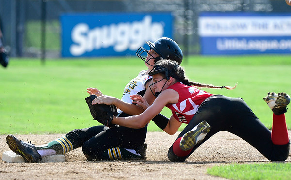7/26/2018 Mike Orazzi | Staff Delaware's Olivia Hitchens (86) and CT's Elena Ohe (21) during the Little League Eastern Regional Softball Tournament at Breen Field in Bristol Thursday.