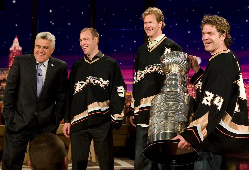 . In this photo released by NBC,  Jay Leno, left stands with team members of The Anaheim Ducks the 2007 Stanley Cup winners, second from left to right: Jean Sebastien Giguere, Chris Pronge and Brad May, with the cup, during the taping of The Tonight Show, on Thursday, June 7,2007, in Burbank, Calif. (AP Photo/NBC,Margaret Norton)