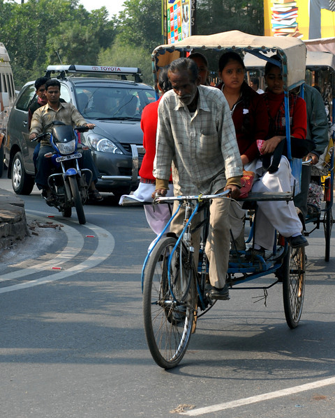 Rickshaw in traffic.