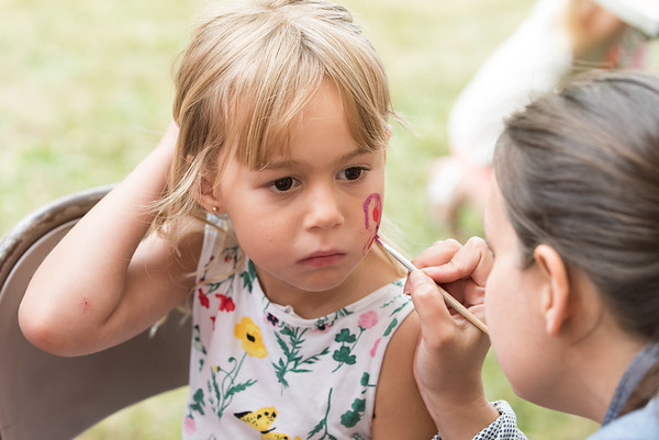 06/21/18 Wesley Bunnell | Staff Zosia Jarzabek , age 4, has a butterfly painted on her face by Michelle Szylobryt at the first night of the Sacred Heart Parish Festival on Friday evening.
