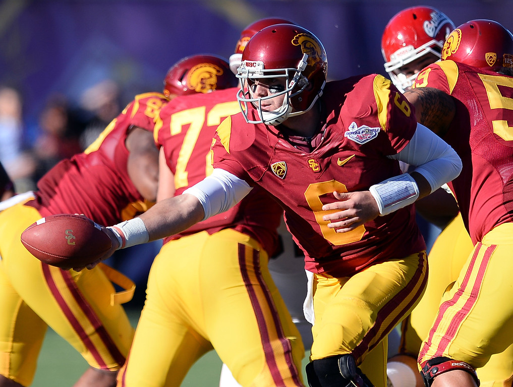 . LAS VEGAS, NV - DECEMBER 21:  Quarterback Cody Kessler #6 of the USC Trojans hands the ball off against the Fresno State Bulldogs during the Royal Purple Las Vegas Bowl at Sam Boyd Stadium on December 21, 2013 in Las Vegas, Nevada. USC won 45-20.  (Photo by Ethan Miller/Getty Images)