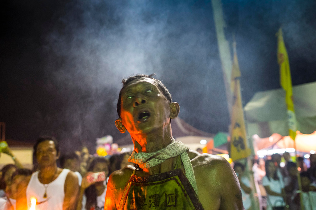 . A devotee works himself into a trance like state outside Ban Tha Rue Shrine during fire walking ceremonies  on September 29, 2014 in Phuket, Thailand. (Photo by David Longstreath/Getty Images)