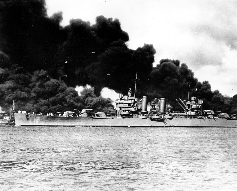 . An undamaged light cruiser steams out past the burning USS Arizona and takes to sea with the rest of the fleet during the Japanese aerial attack on Pearl Harbor, Hawaii, on Dec. 7, 1941 during World War II.  (AP Photo/U.S. Navy)