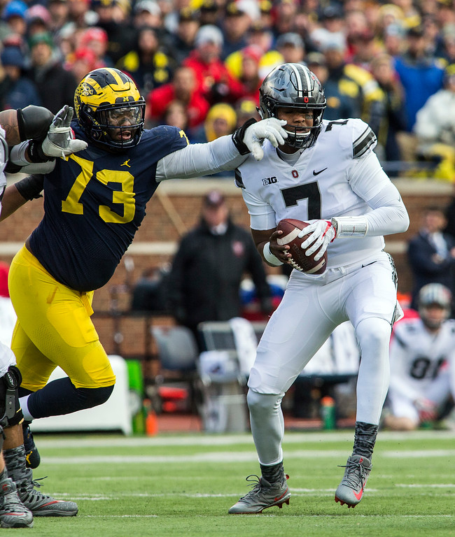 . Michigan defensive lineman Maurice Hurst (73) reaches for Ohio State quarterback Dwayne Haskins (7) during the third quarter of an NCAA college football game in Ann Arbor, Mich., Saturday, Nov. 25, 2017. Ohio State won 31-20. (AP Photo/Tony Ding)