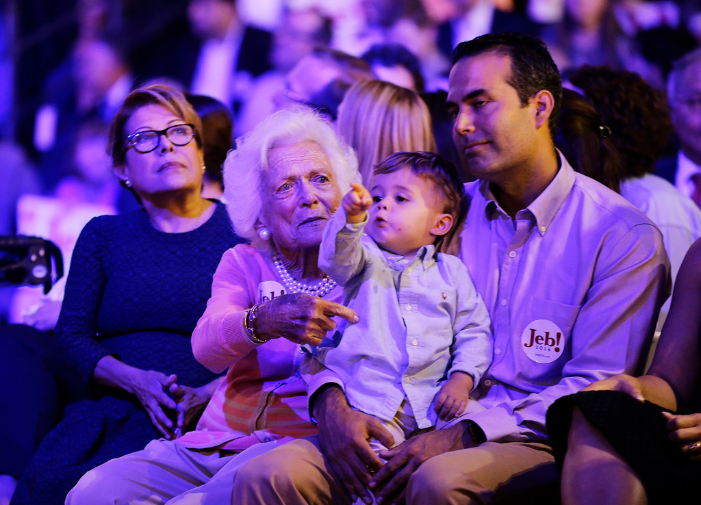 . Former Florida Gov. Jeb Bush\'s wife Columba, from left, sits with his mother Barbara, and son George, holding his grandson Prescott, before he formally joined the race for president with a speech at Miami Dade College, Monday, June 15, 2015, in Miami. (AP Photo/David Goldman)