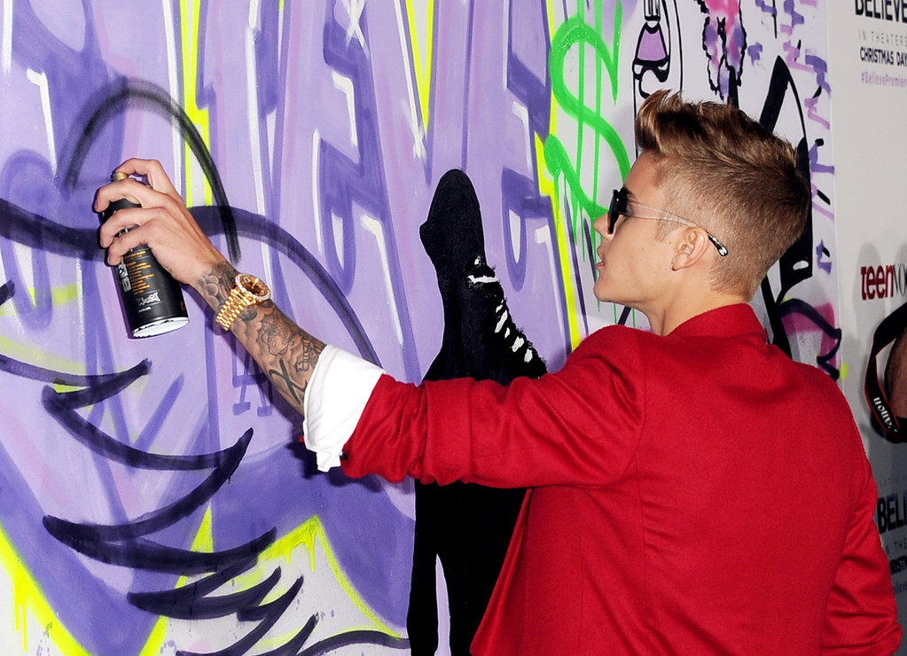 """. LOS ANGELES, CA - DECEMBER 18:  Singer Justin Bieber arrives at the premiere of Open Road Films\' \""""Justin Bieber\'s Believe\"""" at the Regal Cinemas L.A. Live on December 18, 2013 in Los Angeles, California.  (Photo by Kevin Winter/Getty Images)"""