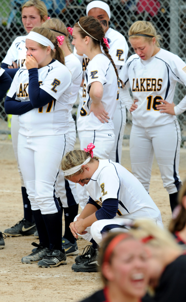 . Prior Lake High School players deal with their disappointment after the loss. (Pioneer Press: Jean Pieri)