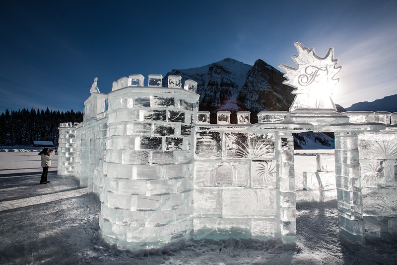 A castle of ice is sculpted in front of the Fairmont Chateau Lake Louise, Banff National Park during the frozen winter months