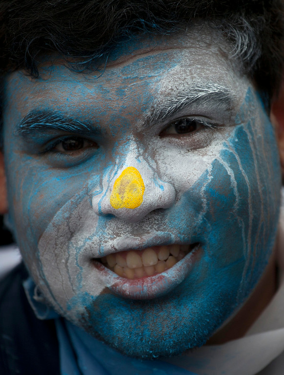 . An Argentine soccer fan decked out in his team\'s national colors, watches the live telecast of the World Cup group F match between Argentina and Nigeria, inside the FIFA Fan Fest area, in Porto Alegre, Brazil, Wednesday, June 25, 2014. (AP Photo/Dario Lopez-Mills)