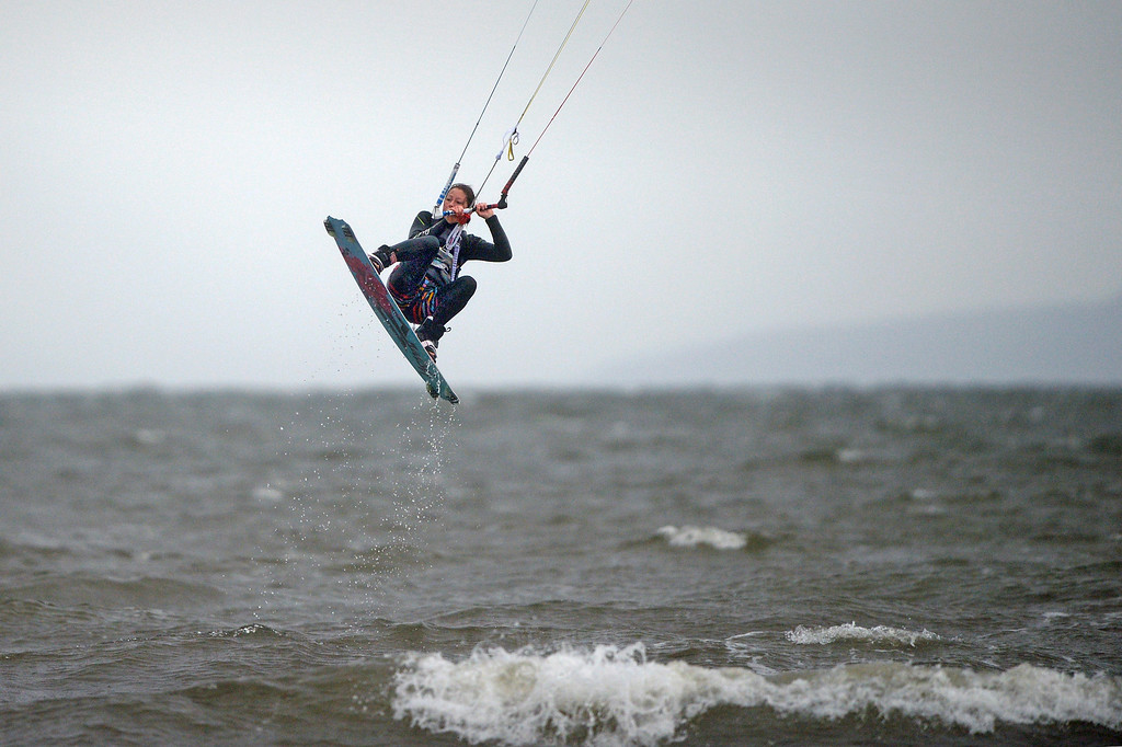 . Alex Conlin enjoys some kite surfing at Troon South beach on October 28, 2013 in Troon,Scotland. Scotland is set to miss the effects of the storm which is hitting the south of Britain, with gusts of 80mph winds causing travel disruption.  (Photo by Jeff J Mitchell/Getty Images)