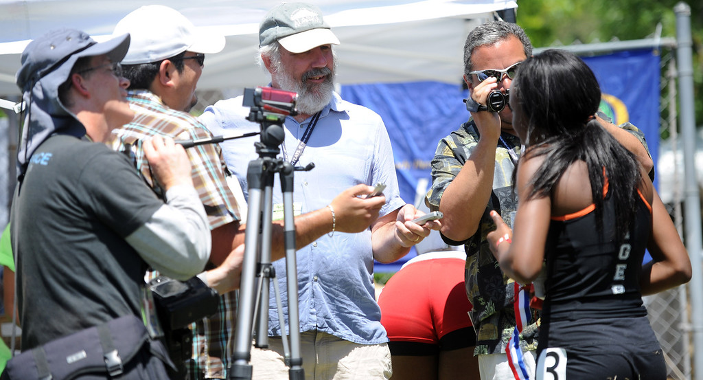 . Reporters interview Laura Anuakpado, right, of South Pasadena during the Mt. SAC Relays in Hilmer Lodge Stadium on the campus of Mt. San Antonio College on Saturday, April 20, 2012 in Walnut, Calif.    (Keith Birmingham/Pasadena Star-News)