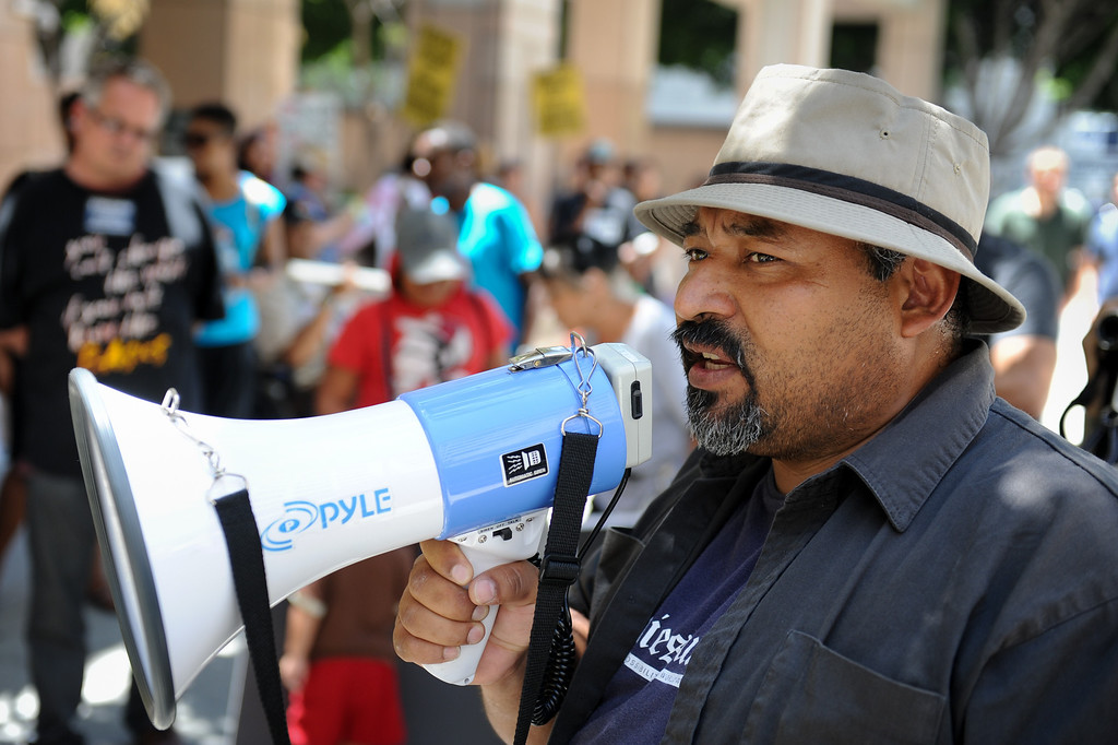 . Alex Sanchez, who did time solitary time in a federal prison, speaks outside the Ronald Reagan State Building in downtown L.A. Monday, July 8, 2013, during a protest against solitary confinement in California prisons. (Michael Owen Baker/L.A. Daily News)