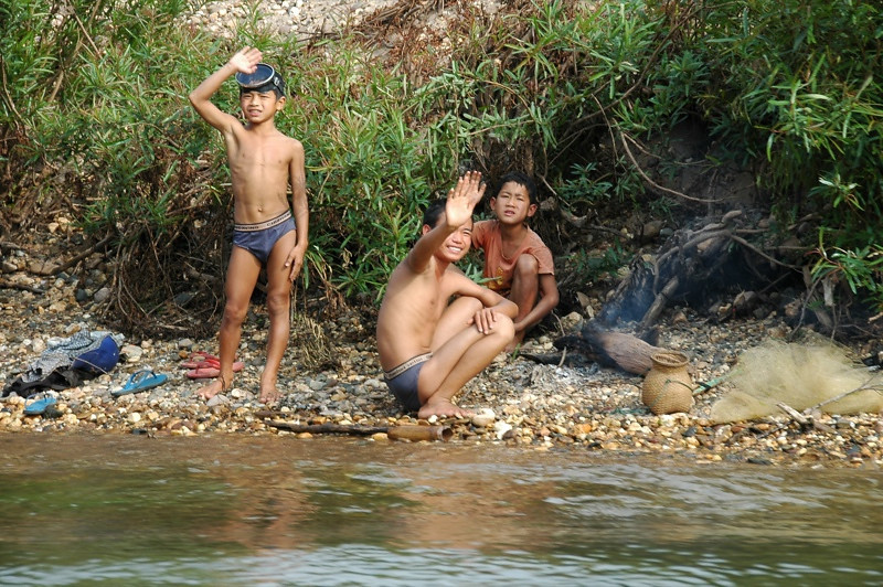 Kids Waving from the Riverbank - Nong Khiaw, Laos