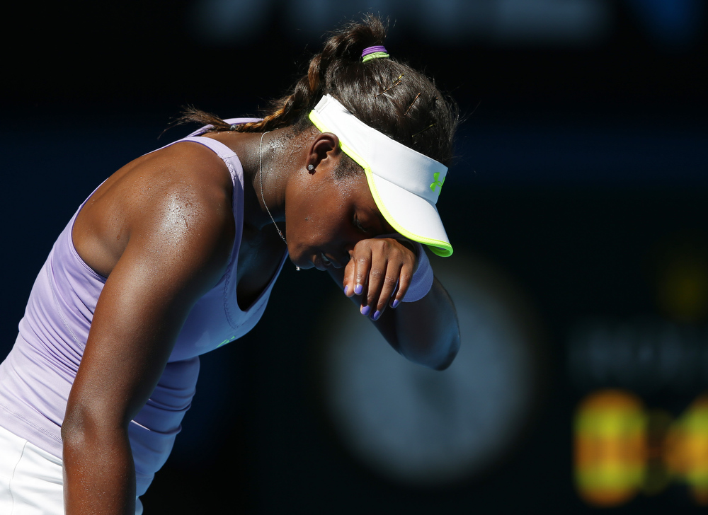 Description of . Sloane Stephens of the US reacts during her semifinal match against Victoria Azarenka of Belarus at the Australian Open tennis championship in Melbourne, Australia, Thursday, Jan. 24, 2013. (AP Photo/Aaron Favila)