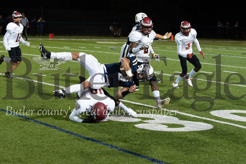 Freeport #8 Garrett King goes fgoes down by Serra Catholic #10 Amire Spenser after a quarterback keep for a first down during a game at Freeport Stadium on Friday, September 24, 2021. (Jason Swanson photo)