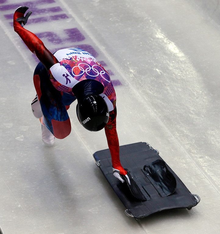 . Sergei Chudinov of Russia starts his first run during the men\'s skeleton competition at the 2014 Winter Olympics, Friday, Feb. 14, 2014, in Krasnaya Polyana, Russia. (AP Photo/Michael Sohn)