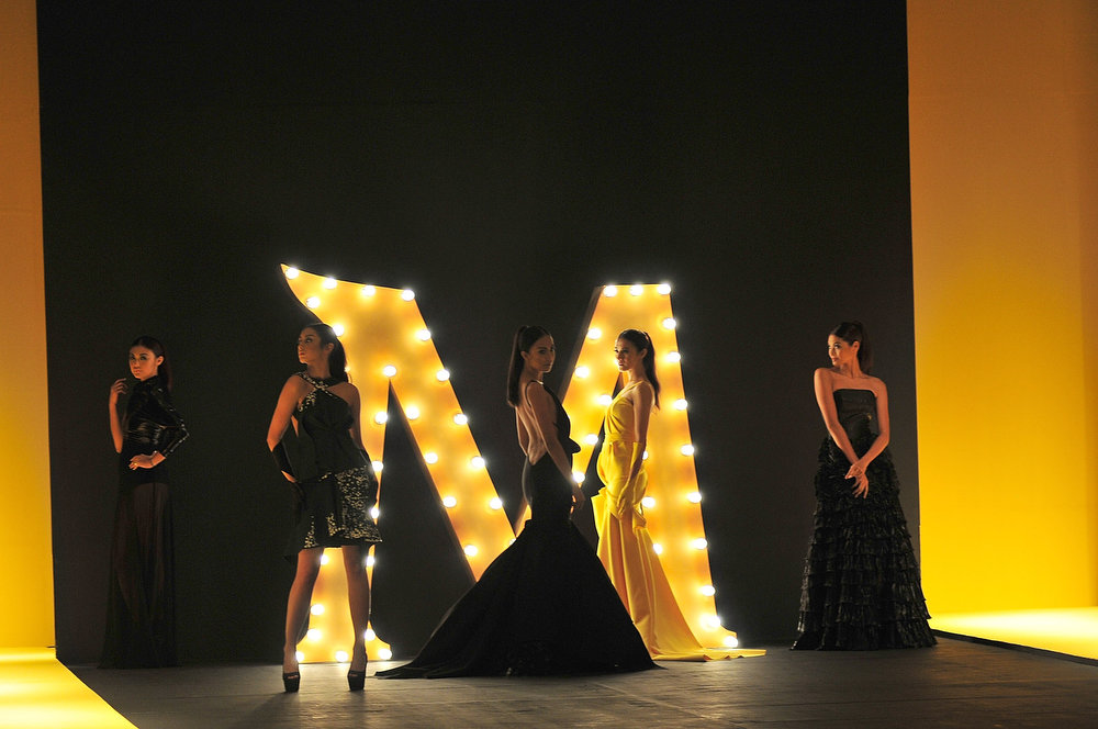 . Models showcases designs by Harley Duenas on the runway at the Magnum ice cream show during the Philippine Fashion Week Holiday at SMX convention center in Pasay City on May 25, 2013 in Manila, Philippines.  (Photo by Veejay Villafranca/Getty Images)