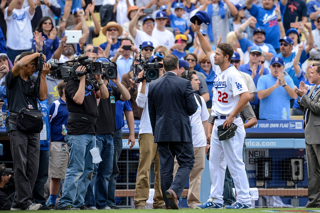 . Dodger\'s Clayton Kershaw waves to the crowd after his winning game on opening day at Dodger Stadium Monday.  Dodgers defeated the Giants 4-0.  Photo by David Crane/Los Angeles Daily News.